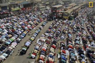 People praying on the street in Dhaka